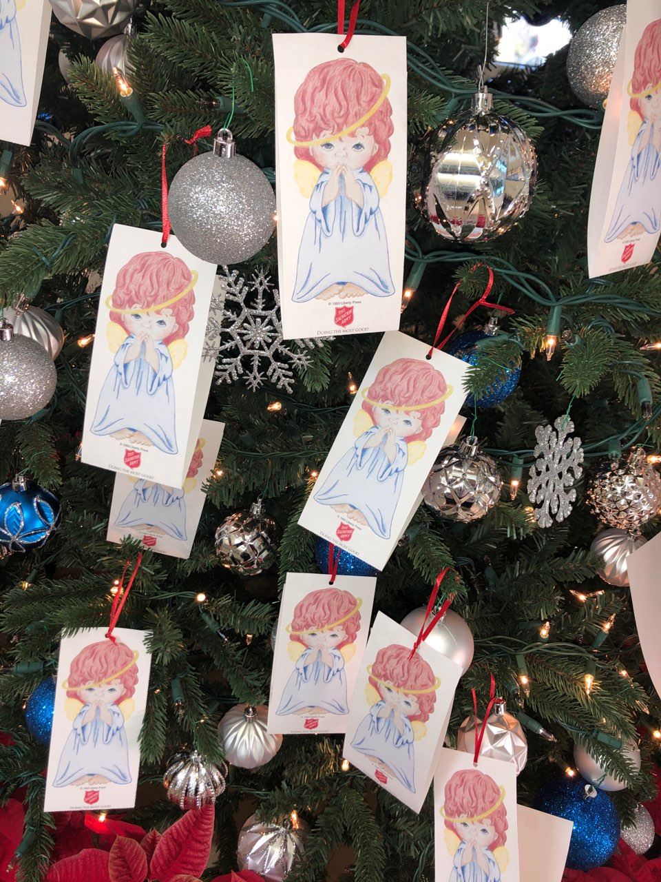 Adopt An Angel Tags on Christmas Tree at Village Hall.