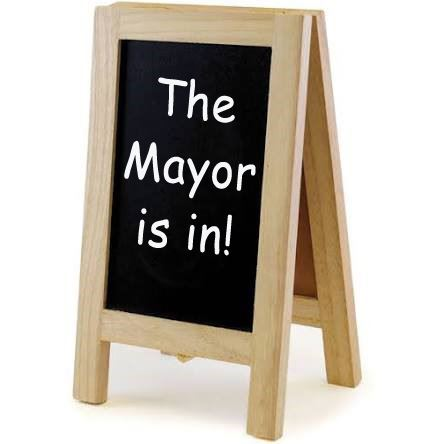 Photo of a chalkboard that says The Mayor Is In.